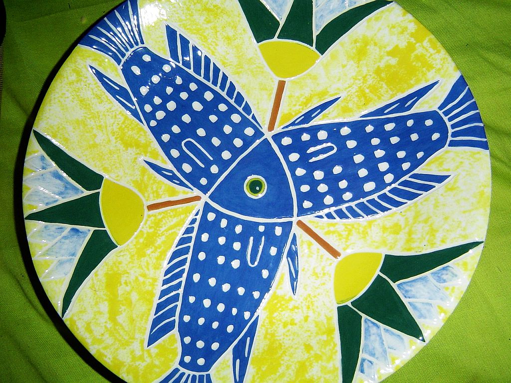 Lotus Fish plate This ceramic plate has been inspired by an 18th Dynasty Egyptian Faience Bowl.